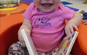 She loves to read! We get new books from the library each month, so there are always new books to help with her literacy development!
