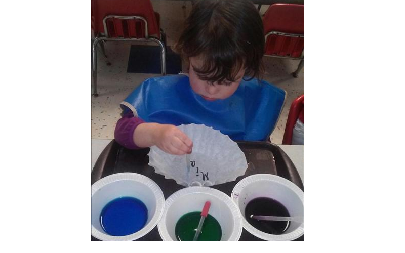 Our Preschool children explore color mixing in the Science Area.