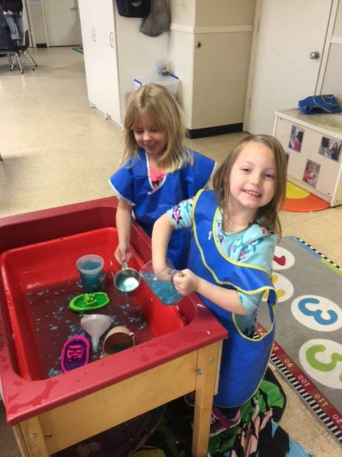Exploring with cars, trucks, and water in Prekindergarten.