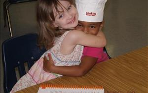 Children in action at our Learning Adventures cooking classes.