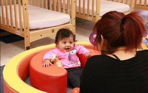 Babies enjoy engaging with teachers, while building trusting relationships outside of the home.
