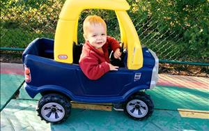 The two-year-olds love to drive the cars outside!