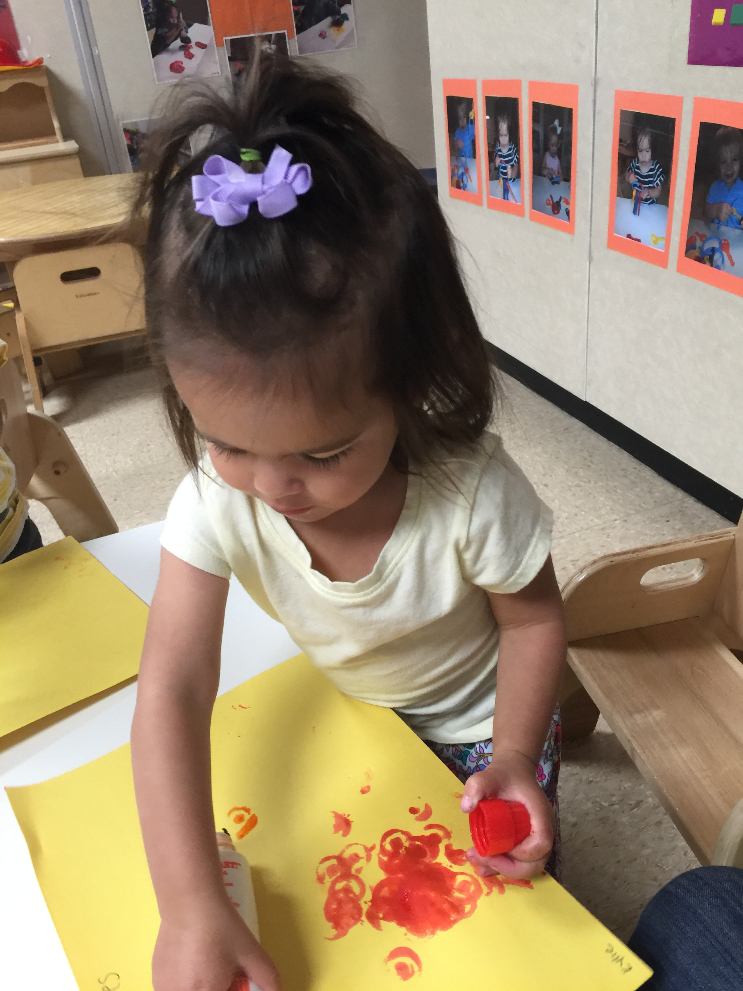 Our toddler room uses a variety of art materials to foster creative expression.