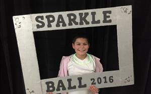 Striking a pose in the photo booth at our Sparkle Ball in January, 2016!