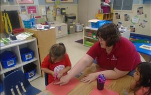 Ms. Jenna and our Prekindergarten Classroom begins to build physical development by using scissors to cut simple shapes.