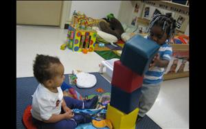 Making block towers and knocking them down is one of the infants favorite activities!