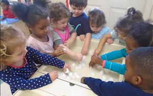 Our twos love hands-on learning!