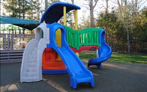 Discovery Preschool, Preschool, Prekindergaren and School Age Playground climbing structure with rubber play surface.