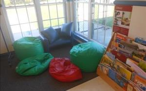 A cozy reading place for our school age students to take a break and read a good book.