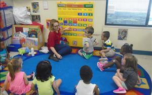 Ms. Calyn and our Preschool class is showing us cognitive development by conecting number words to their numerals.