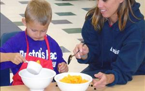 Our Cooking Adventures class is more than just fun.  Children also learn about foods from other cultures, vocabulary, fine motor skills, eye/hand coordination, self - confidence, social skills and how eating healthy can be so easy.  In this class we let our parents have some fun too!