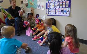 Our Preschool students with Mr.Trey creating a puppet show!
