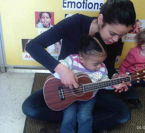 Here you can see our Discovery Preschool teacher teaching our children all about the Banjo! Miss Marilex enjoys playing the Banjo in her spare time and takes pride in incorporating this multicultural musical instrument into the children's classroom curriculum!