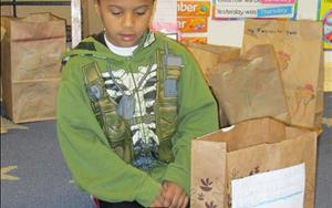 "Kise in Kindergarten is displaying his hard work he completed for his ""Brown Bag Book Report"""