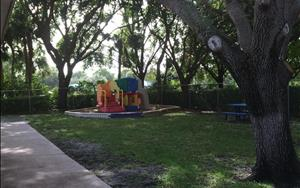 Our playground provides lots of room to run around and climb twice a day under the beautiful mature trees that keep our playground cool from the Florida sunshine.
