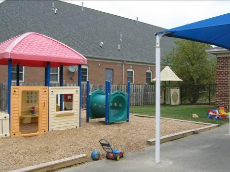 Our Toddlers have a great open space to enjoy climbing, walking, drawing or just running around. It is loaded up with bikes and cars for them to ride in, and push around.  We make sure we take our creativity outside with our sidewalk chalk and paint as well.