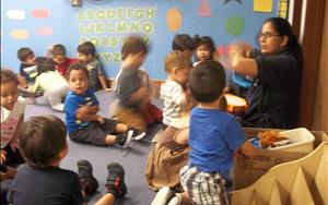 Our Toddler teacher Ms. Shashi, doing Music Adventures with Toddlers and Twos classes.