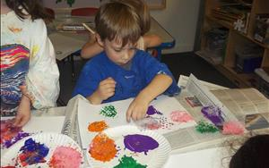 Bubble wrap painting fun in the Preschool classroom.