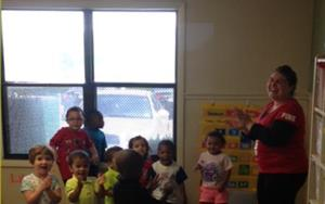 Mrs. Kammy dancing with the Discovery Pre-school class