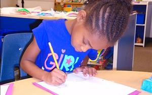 School Agers work in individual journals in our after school program.