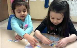 Children learn to work together to complete challenging activities.