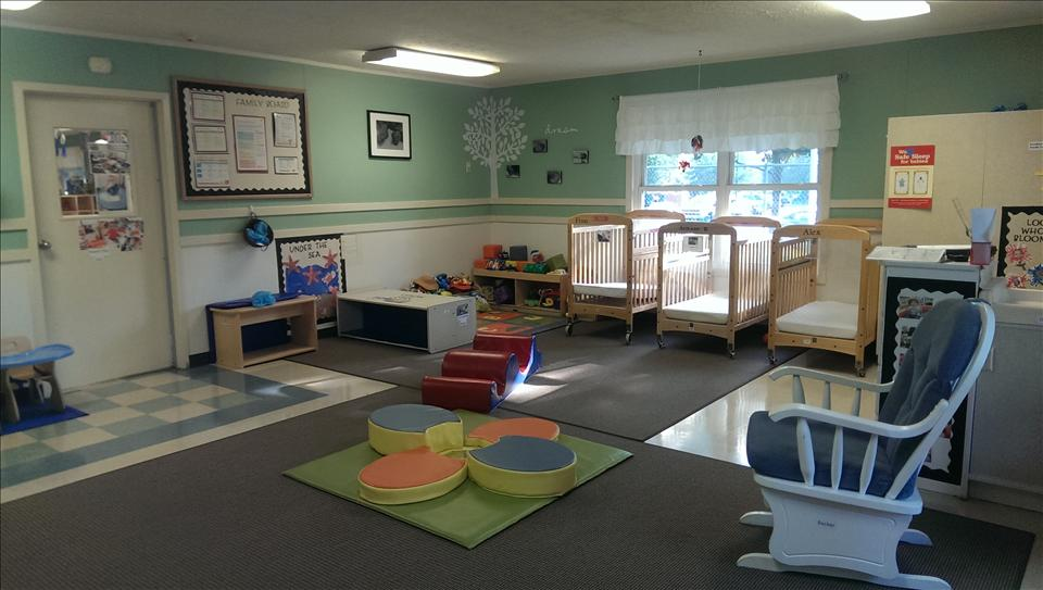Our older infant classroom is for our mobile infants.  This larger, least restrictive room allows our older infants the freedom to move every part of their body, whenever he/she desires, as he works towards all those critical milestones.  Our teachers work with the older infants on crawling, standing, walking, etc.  They sing, read, and constantly talk to their babies.