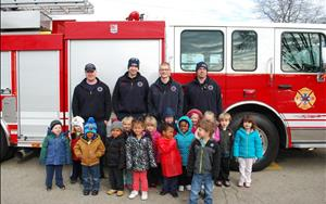 Englewood's Finest come in to visit with their firetruck