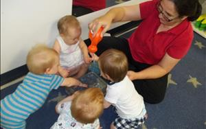 Mrs. Afsaneh leads our infant explorers in recognizing the sense of touch in this water sensory activity.