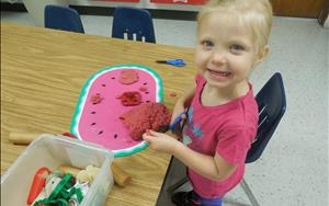 In Preschool, playdough is a great way to introduce the use of scissors.