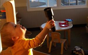 Toddlers exploring light and dark!