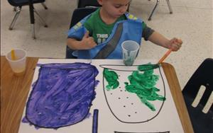 Nathan working on his creative expression in preschool.