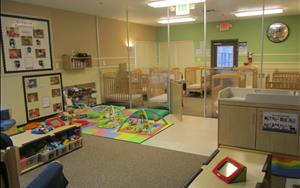 We provide a least restrictive environment for our infants. We want them to be able to explore the room, have access to their toys, and to interact with teachers and other children.