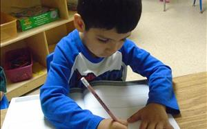 Our preschoolers write in their journals daily.