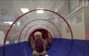 Our infants are having fun with tunnel time! What an exciting way to teach our little ones while developing their gross-motor skills!