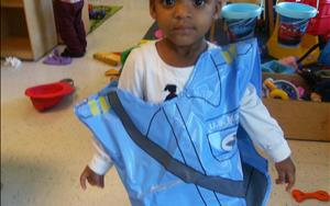 Discovery Preschool student playing in dramatic play area.