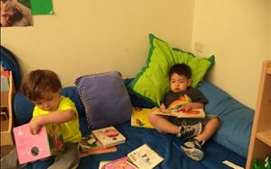 Relaxing and reading books in our soft play area.