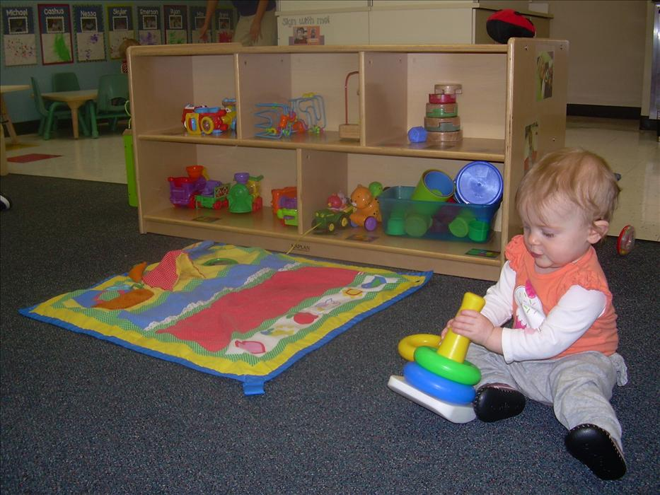 Our infants are busy working on problem solving and hand-eye coordination with the stacking rings in the classroom.