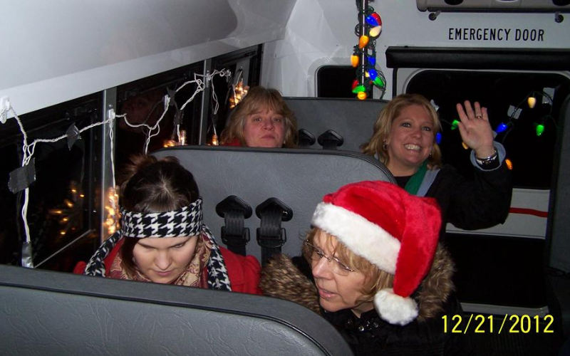 Our teachers having fun driving to our families homes to sing!