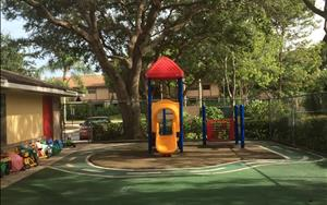 Our toddler playground is perfectly sized for our younger students, and separated from the older students. This allows our younger ones to play freely under the shade of our mature trees that keep the playground cool.