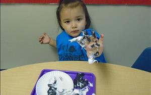 Practicing creative expression in Discovery Preschool.