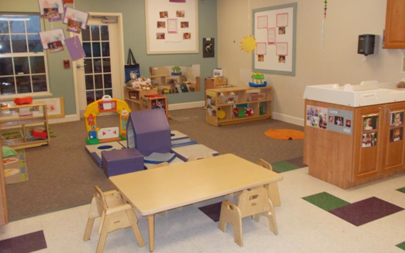 Our youg toddler room gives our transitioning babies lots of fun activities at their level as they gradually stabilize on their feet.