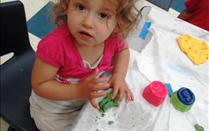 You might see a student playing with play dough.  Did you know she is also working on her fine motor skills, eye/hand coordination, shape and color identification, vocabulary, and social skills too? We did. It's part of the educational standards we use when we plan activities like this for our day!