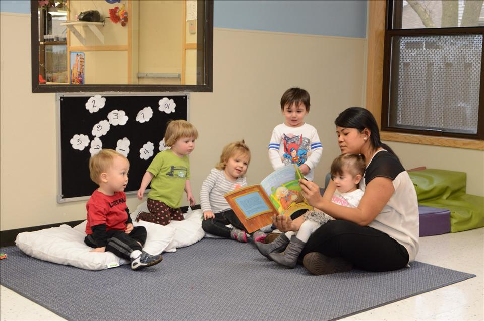 Miss Sarom keeps the toddlers engaged with an interactive story.