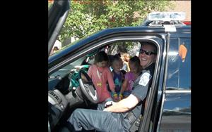 Fun with our Community Helpers!! How many kids can we squeeze into  police car??