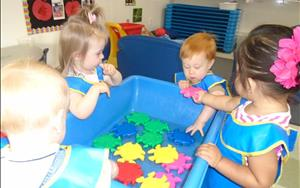 We give toddlers the opportunity to explore various types of textures in the sensory table. Today we are playing in the water with fish!