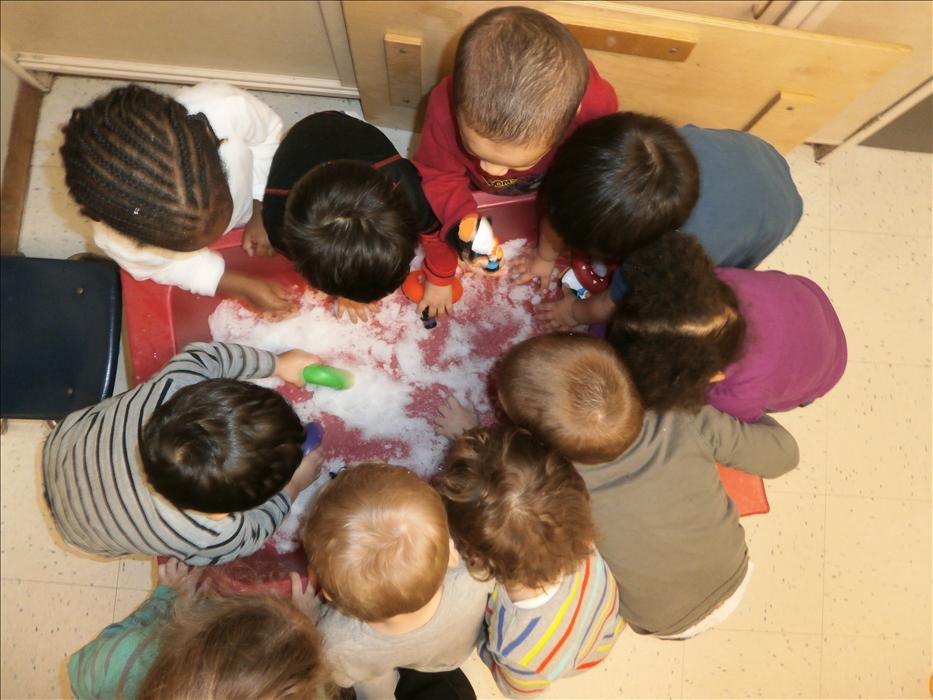 Discovery preschool enjoying snow in their sensory table.