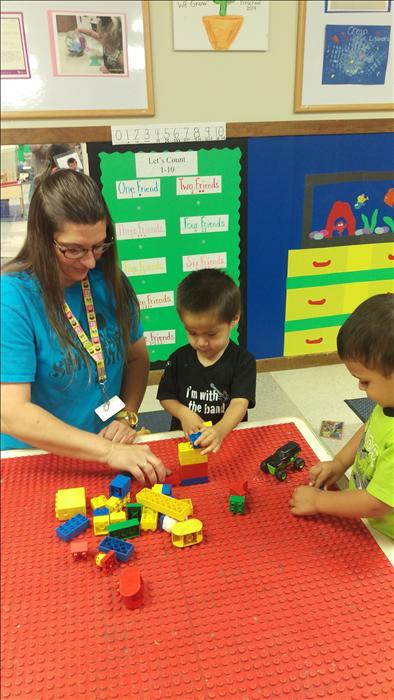Our Discovery Preschoolers complete simple tasks when stacking blocks to build a tower.