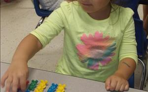In our Pre-Kindergarten Program, the children love learning new things! Such as, exploring basic mathematical operations to prepare them for Kindergarten!