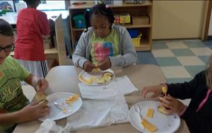 School Agers make a sailboat using various foods