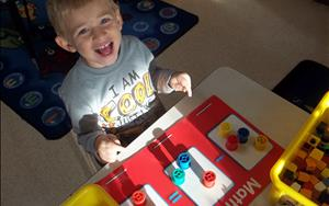 One of our Pre-K students learning about addition, subtraction, multiplication, and sorting!